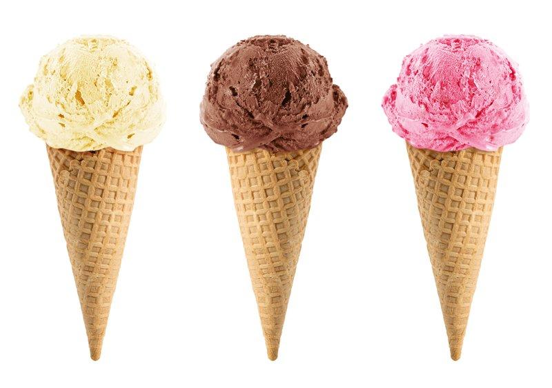 Chocolate, vanilla and strawberry Ice cream in the cone on white background.