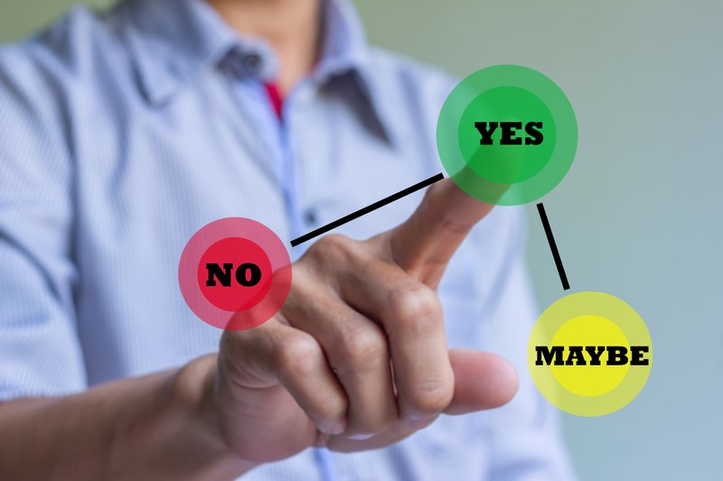 Image of a man tapping on a virtual screen. There are three options 'Yes', 'No' and 'Maybe'. The person is tapping on 'Yes' to indicate he has thought about his career options.