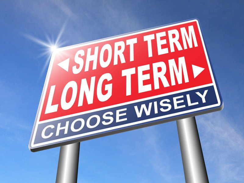 long term short term strategy planning or thinking plan and think ahead for the near and far future road sign arrow. The image indicates how long-term thinking is needed when we plan our saving.