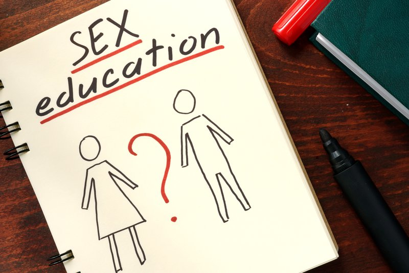Words sex education written in the notepad.