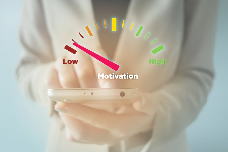 woman using smartphone with meter indicator :Low Motivation