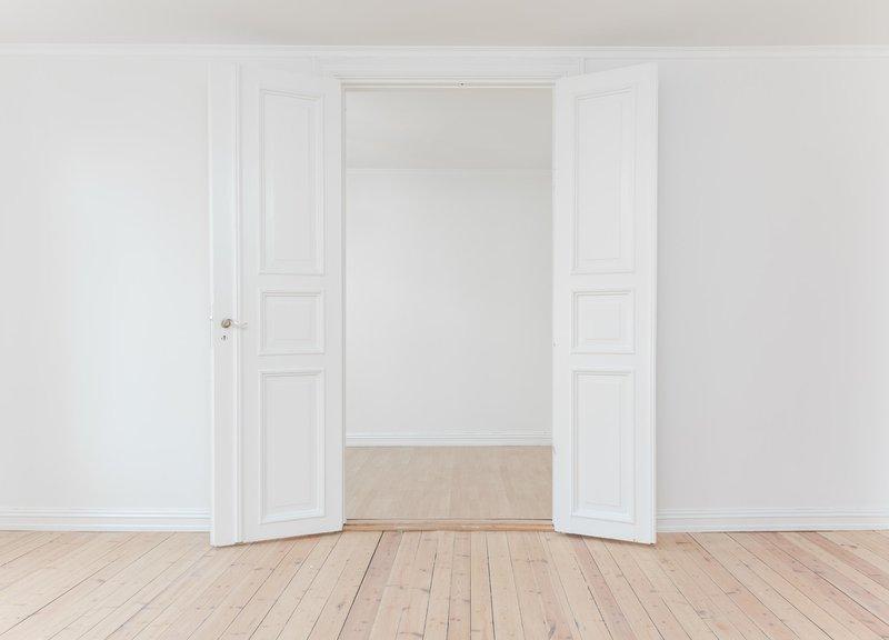 Door in a white room