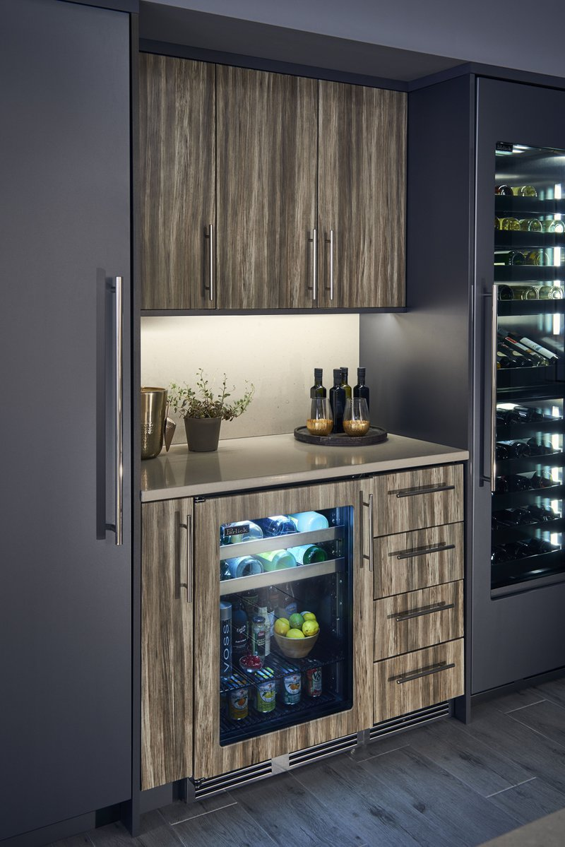 A small wet bar with thermofoil cabinets.