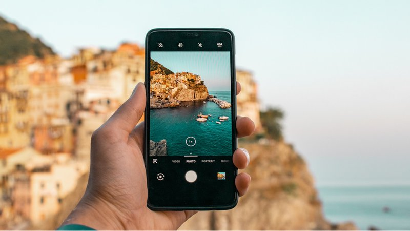 A mobile device with an ocean landscape in the background