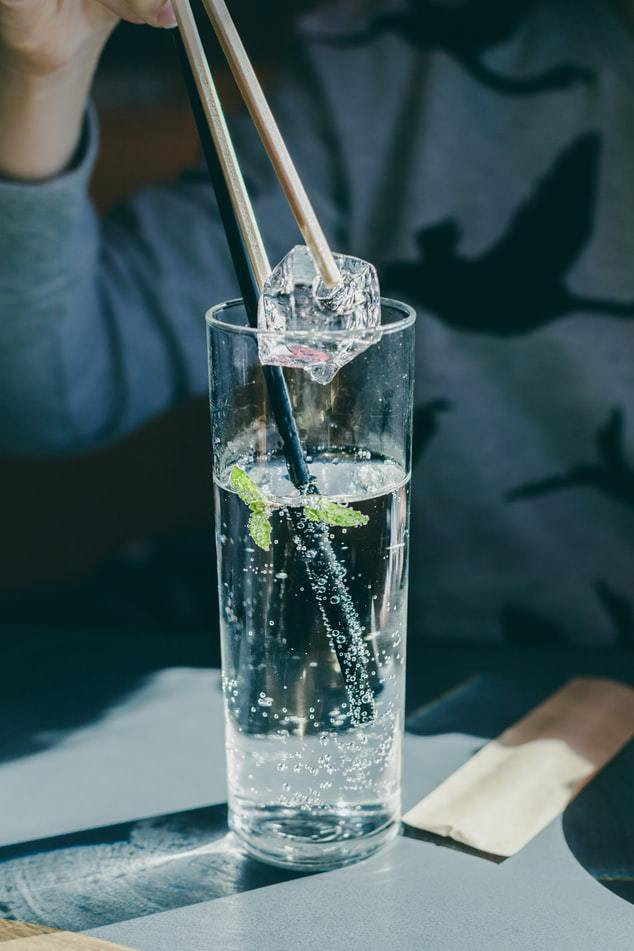 glass of sparkling water with ice healthy alternative to soda