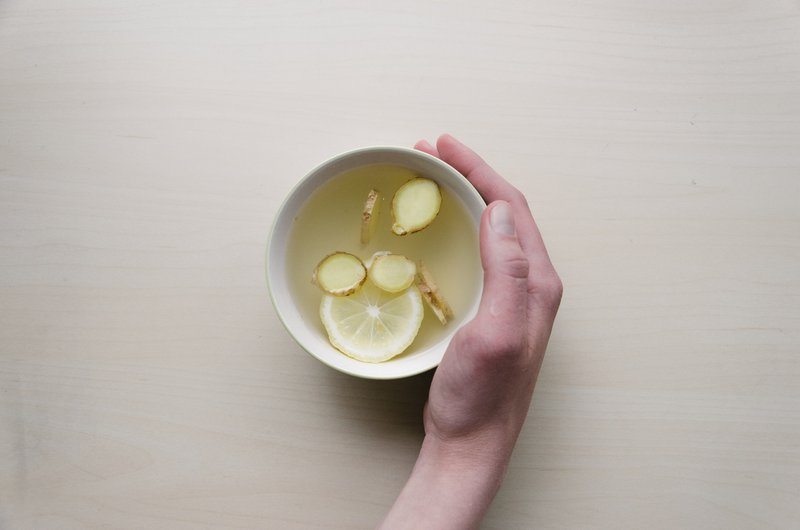 a cup of ginger tea with lemon better than juice fore a sore throat