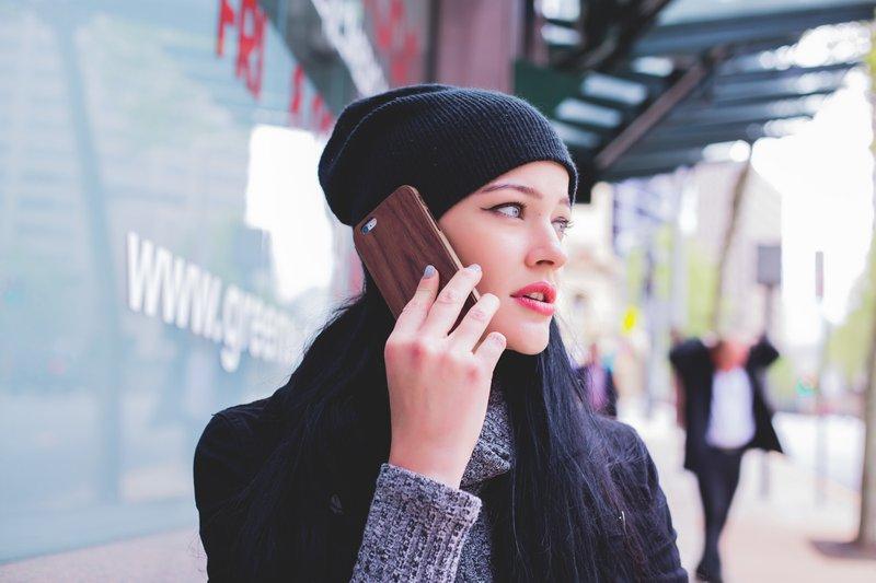 On a phone on a sidewalk