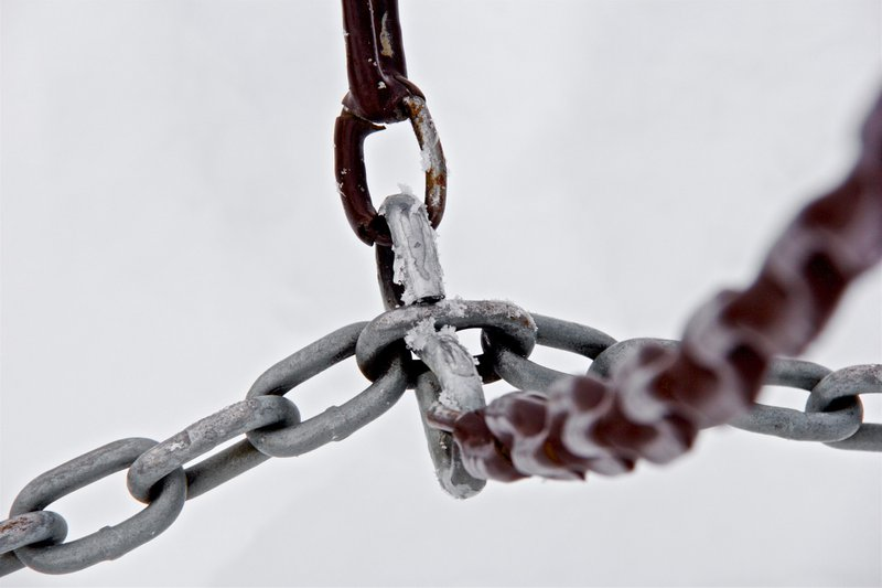 selective focus photograph of gray metal chains