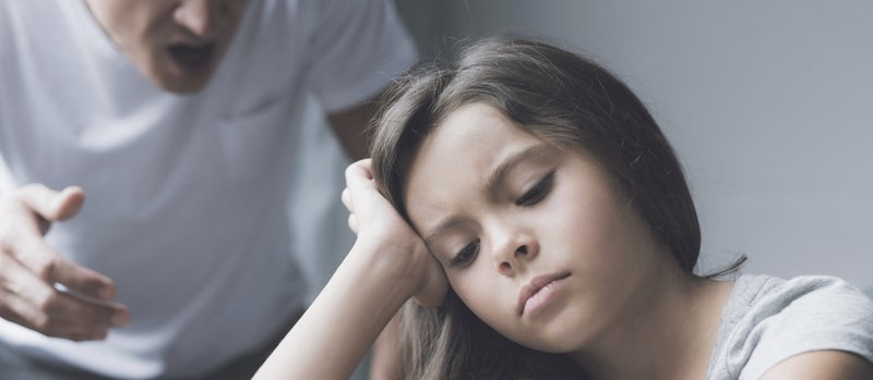 I do not want to do homework. The girl with an indifferent glance sits at the table, propping her head in her hand, while her father screams at her