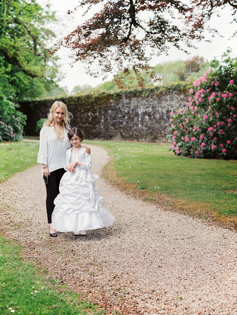 Girl in communion dress with her mum in Johnstown Castle Wexford