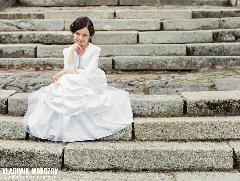 Girl in white dress sitting on the steps of Johnstown castle Wexford