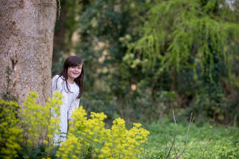 Little girl behind the tree in Kennedy Park Wexford