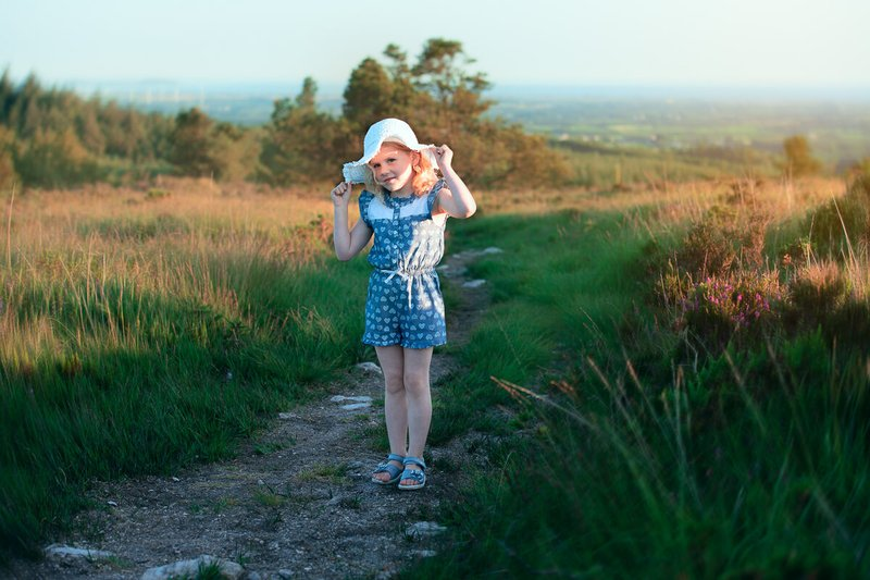 Girl with white hat posing for a family photo in forth mountain Wexford