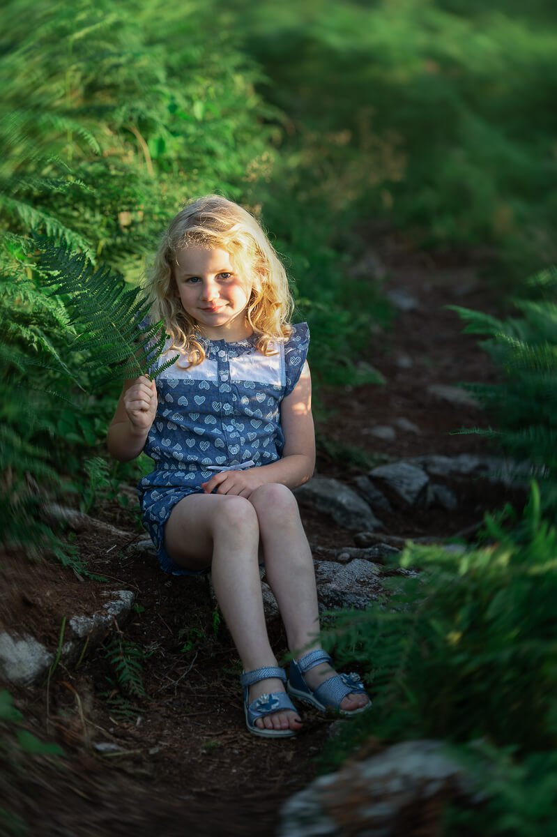girl sitting on a rock in forth mountain Wexford during family session