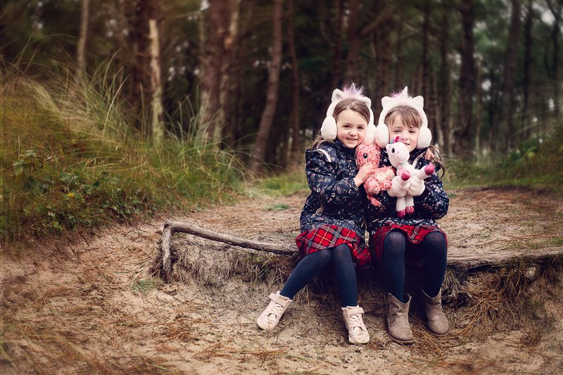 two little sisters sitting on the bench in Raven point Wexford during family photo session