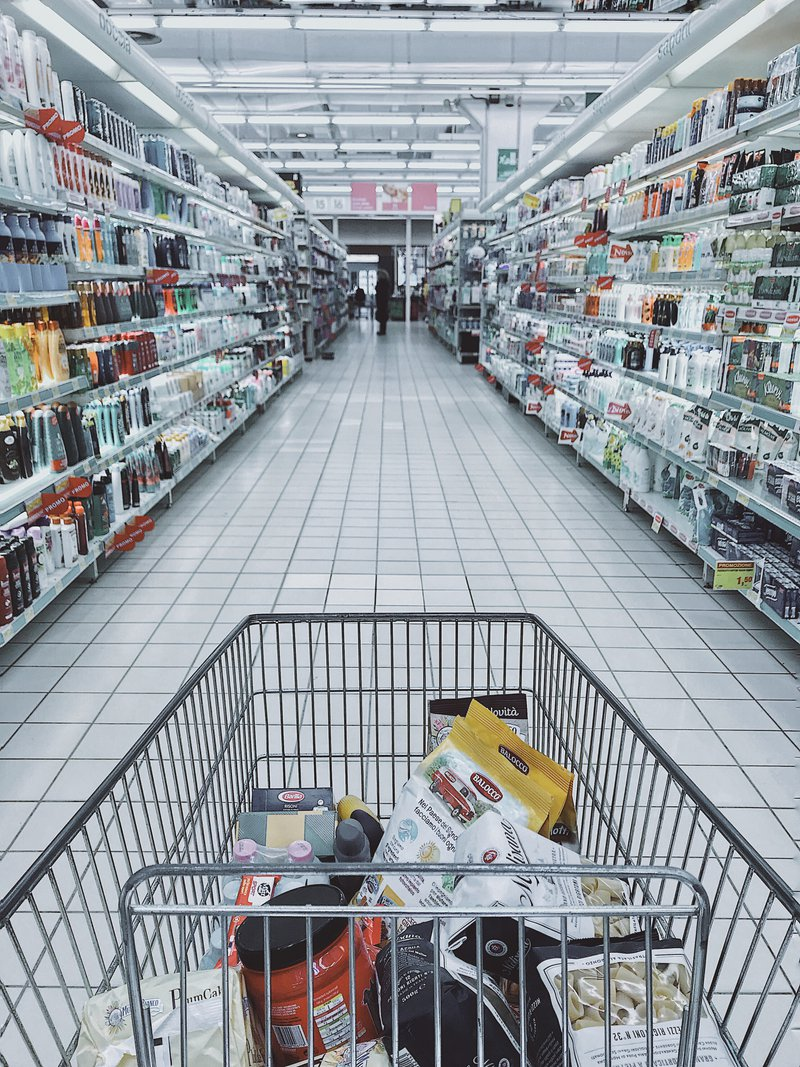 items in a grocery cart in a physical store isle