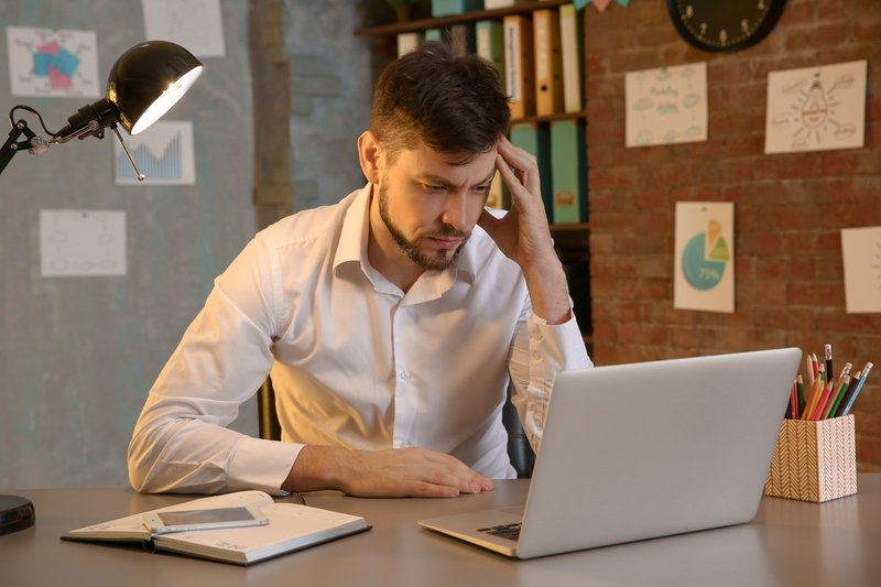man frustrated with computer