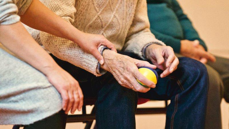 elderly man holding ball for pain management in tupelo, ms