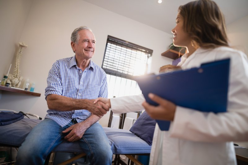 patient shaking doctor's hand at pain treatment centers