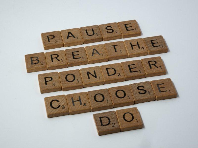 scrabble, scrabble pieces, lettering, letters, white background, wood, scrabble tiles, wood, words, pause, breathe, ponder, choose, do, panic, don't panic, decide, stop, indecision, stuck, overwhelmed, despair,