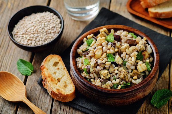Roasted eggplant pine nuts mint barley salad. toning. selective focus