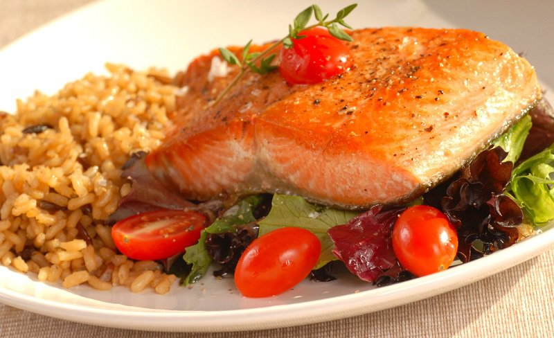 Pan-Seared Salmon and Herbed Brown Rice is a tasty fatigue-fighting dish.