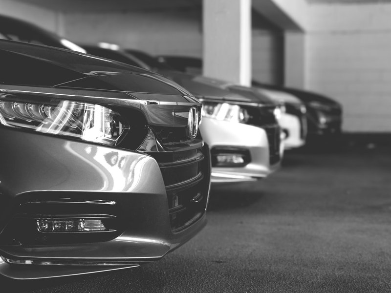 Black and white photo of a row of Honda Accords at a dealership in Fairfax Virginia with emphasis on the headlights.