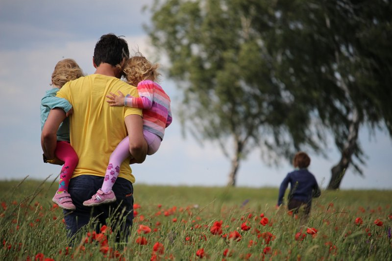 Dad With Kids In Field