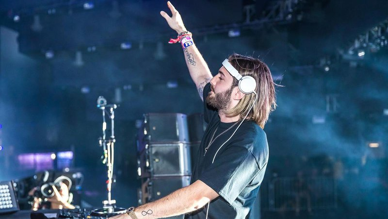 DJ Alesso performing on stage