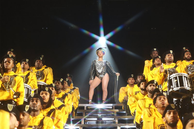 Dancers and a marching band join Beyonce on stage