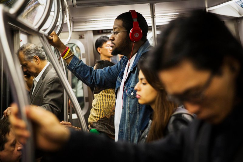 Commuter listening to music on the subway