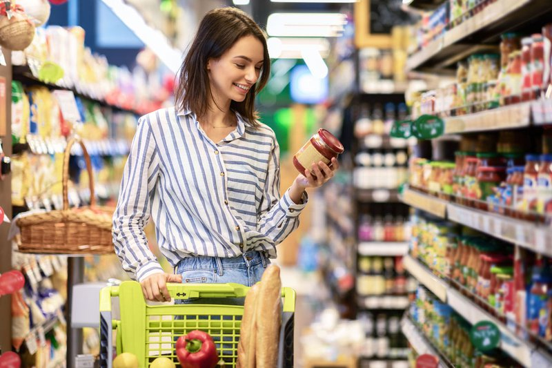 A woman looking at the new changes to Canadian food labels at a grocery store.
