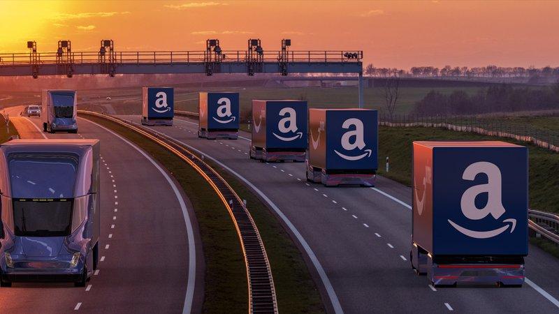Amazon trucks on a highway