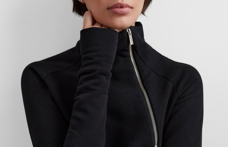 lady in black top with zipper - Marcella NYC