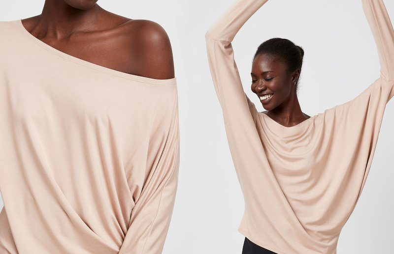 lady in beige top with arms raised-minimalist clothing- MarcellaModa NYC