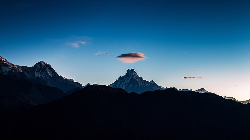this Cloud UFO over the Mount Fishtail photo was taken during Poonhill trek, Nepal