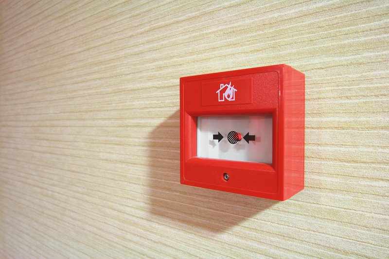 Fire alarm security button on a wall