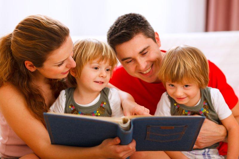 Family looking photo album