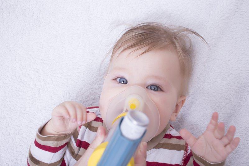 Infant using an asthma inhalator
