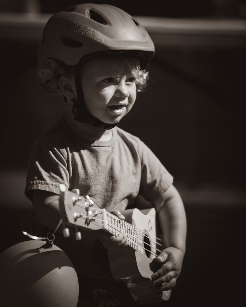 Future rockstar at a backyard jam session in Santa Cruz, California.