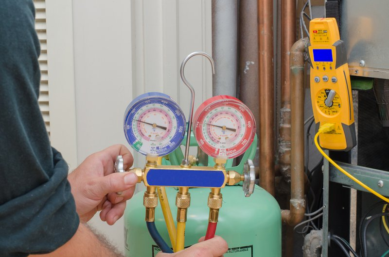 Charging a residential heat pump system with refrigerant