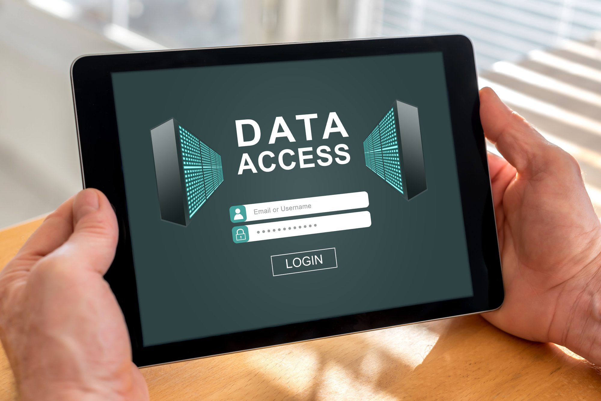 Digital Marketing Challenges - Male hands holding a tablet with data access concept