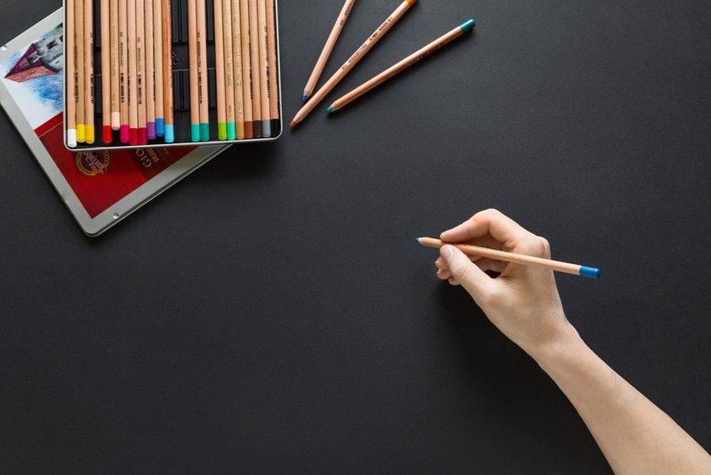 Blue pencil against black paper