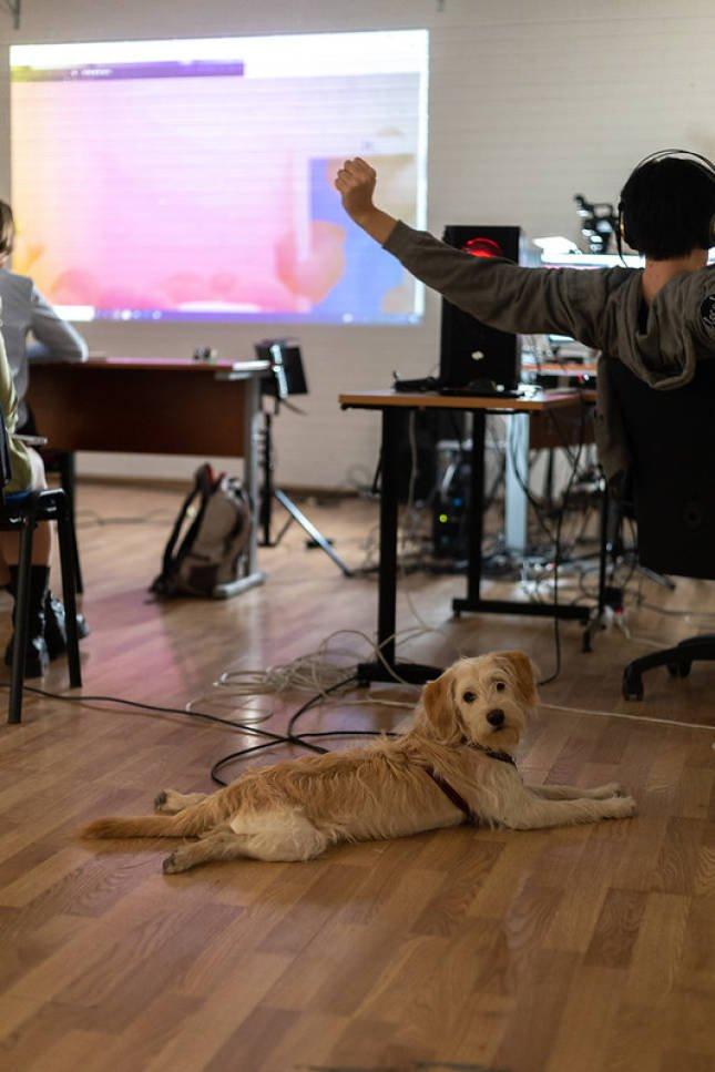 graduates present in an unorthodox, creative work environment