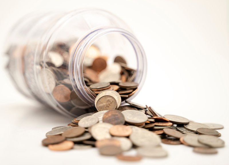 coins falling out of a jar