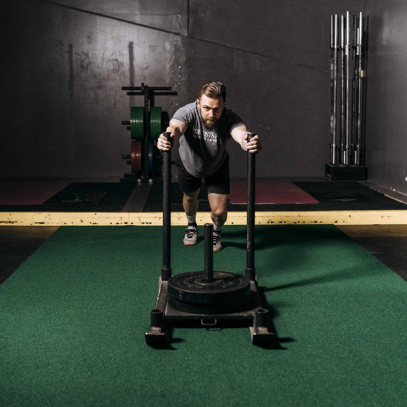 Adaptogens can help support intense training schedules like pushing a sled