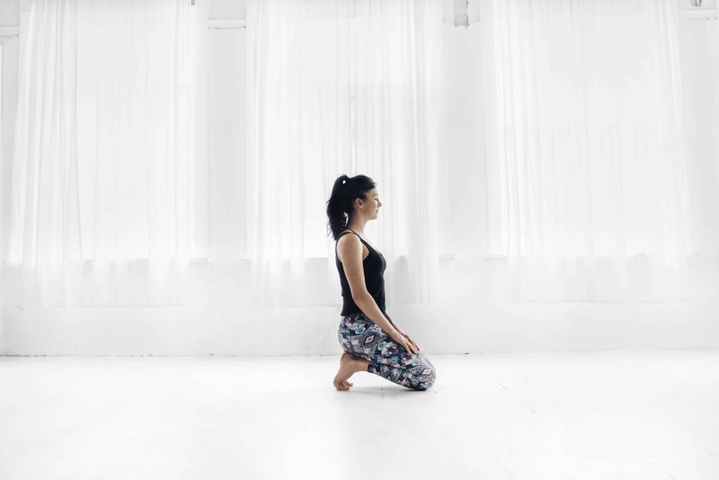 woman meditating in a yoga studio