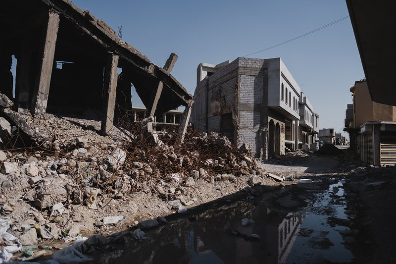 View of typical ruins in the Old City of Mosul after war with the Islamic State, as well as signs of reconstruction.