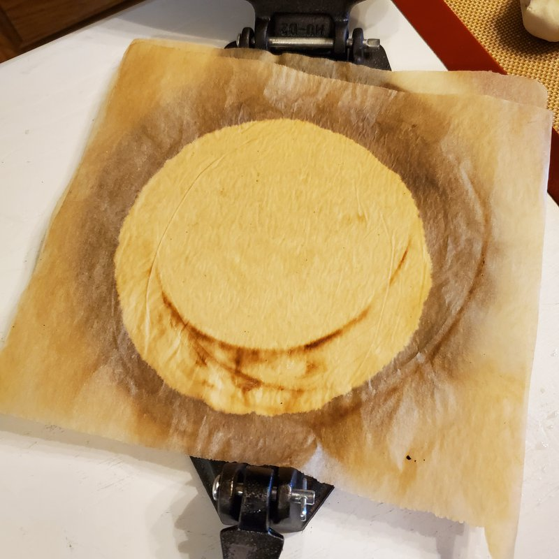 Gently press the dough into a tortilla