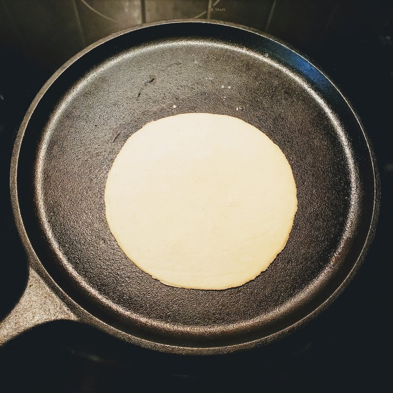 Allow the tortilla to cook until bubbles start to form